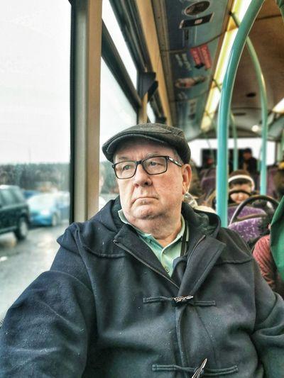 Portrait of man wearing sunglasses in bus