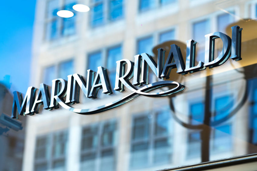 Marina Rinaldi store exterior. Marina Rinaldi is a ready-to-wear, plus-size women's clothing brand of the Italian Max Mara Fashion Group Boutique Clothes Store Fashion Apparel Brand Building Exterior Clothes Shop Clothes Shopping Clothing Shop Clothing Store Focus On Foreground Information Marina Rinaldi Max Mara No People Outdoors Sign