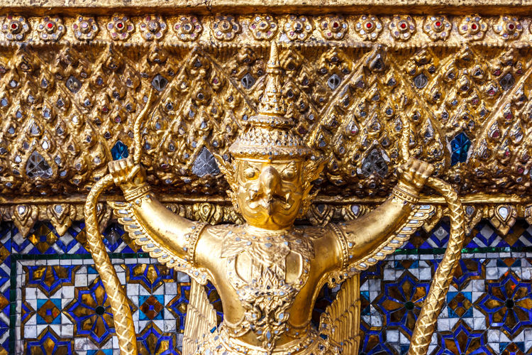 Closeup of demon statue at the Ubosoth the main temple in the Wat Phra Kaew Palace, also known as the Emerald Buddha Temple. Bangkok, Thailand. Architecture Bangkok Thai Thailand Wat Phra Kaew Architecture Art And Craft Buddhism Gold Colored Human Representation Landmark No People Place Of Worship Religion Representation Royal Palace Sculpture Spirituality Statue Travel Destinations