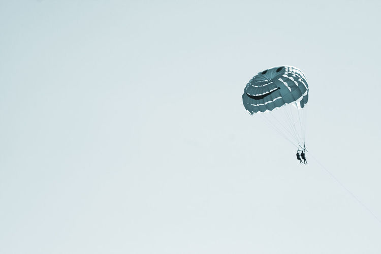 Low Angle View Of Parachute In Air Against Clear Sky
