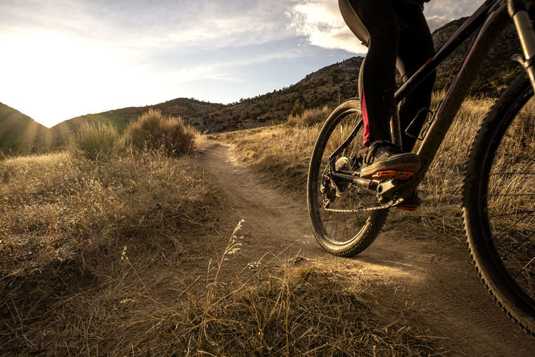 Bicycle on dirt road in field
