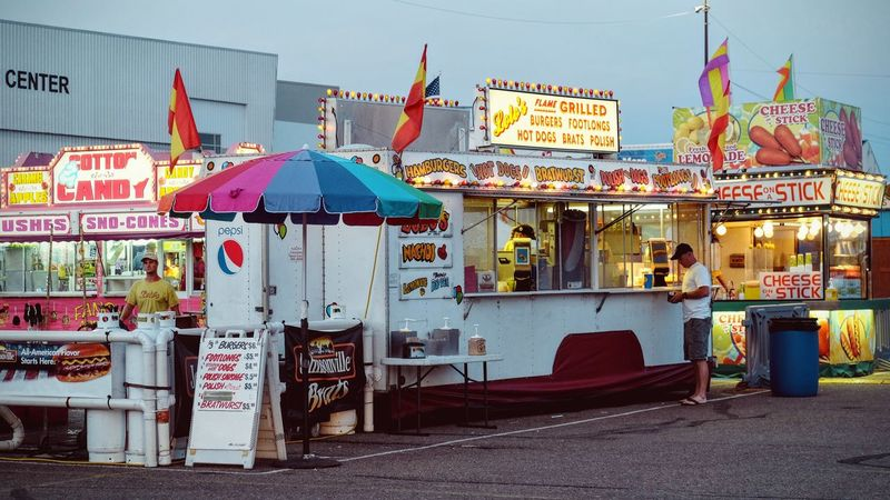 Nebraska State Fair August 2016 Grand Island Nebraska America Americans Built Structure Camera Work Carnival Food Collection Cultures Eye For Photography EyeEm Best Shots EyeEm Gallery Fairground FUJIFILM X-T1 In Front Of Lifestyles Multi Colored Nebraska Outdoors Photo Essay Photojournalism Retail  Selects Small Town Stories State Fair Umbrella Variation