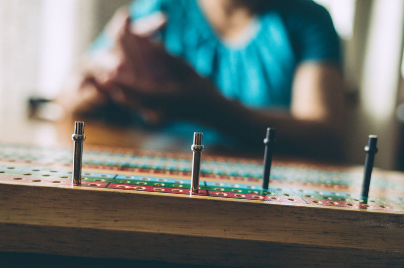Cribbage Cards Close-up Day Focus On Foreground Indoors  One Person People Playing Real People Sitting Table