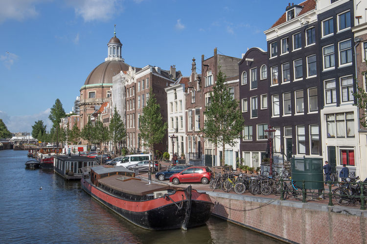 Amsterdam Barge Netherlands Architecture Building Building Exterior Built Structure Canal Canal House City Day Dutch Houses Holland House Boat Incidental People Mode Of Transportation Moored Nature Nautical Vessel Outdoors Passenger Craft Residential District Singel Sky Tourism Transportation Travel Travel Destinations Water Waterfront