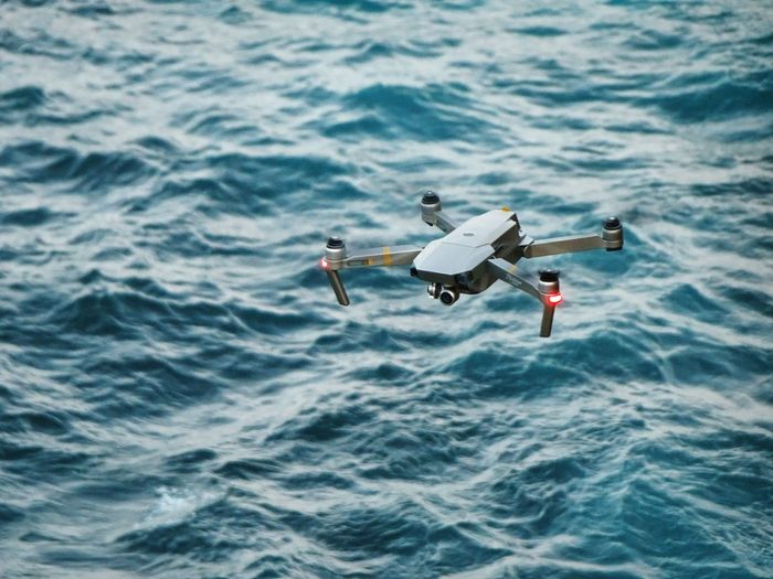High angle view of drone flying over sea