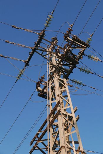High Section Of Electricity Pole Against Blue Sky