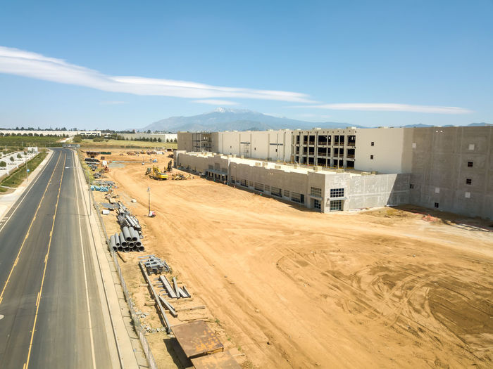 Beaumont, CA / USA - 4/20/2019: Overhead view of a new Amazon Fulfillment Center under construction. High Angle View Day Architecture Built Structure No People Outdoors Construction Construction Site Warehouse Distribution Logistics Equipment New Building  Amazon Overhead View Transportation Road Building Exterior Sky Mode Of Transportation Sunlight Land Vehicle Nature City Car Motor Vehicle Environment Cloud - Sky Street