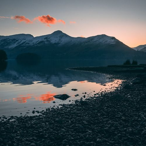 Sunset colours EyeEm Selects Mountain Reflection Lake Sunset Nature Beauty In Nature Water No People Tranquility Scenics Outdoors Landscape Mountain Range Sky Wilderness Area