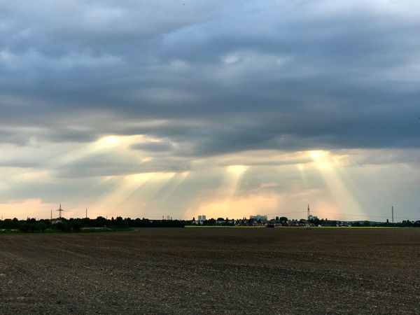 Sky And Clouds Beams Of Light Soil Heavy Sky Sunset Industrial Landscapes No People Ray Of Light