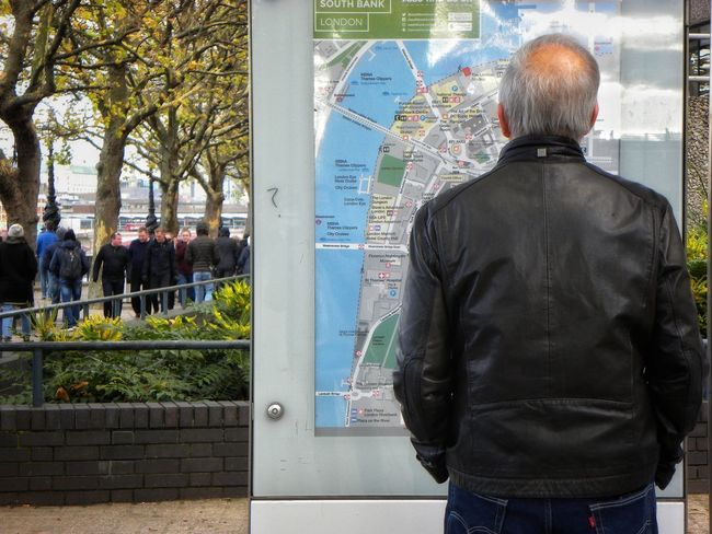 Rear View One Man Only Adult Standing One Person Outdoors Sky City Day Real People City Life Map City Map Reading A Map Direction Information Board Lost Lost In The City Looking For Direction