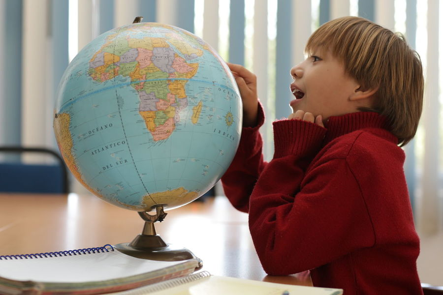 Earth Kids School Uniforms Around The World Astronomy Childhood Classroom Moments Close-up Day Earth 🌏 Is Beautiful Education Enjoying Life Focus On Foreground Home Work Homework Indoors  LearningEveryday Leisure Activity Map Notebook One Person Real People Standing Table