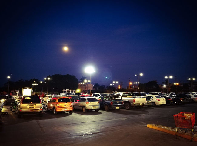 Night Illuminated Car Outdoors City No People Sky Moon Clear Sky Cityscape