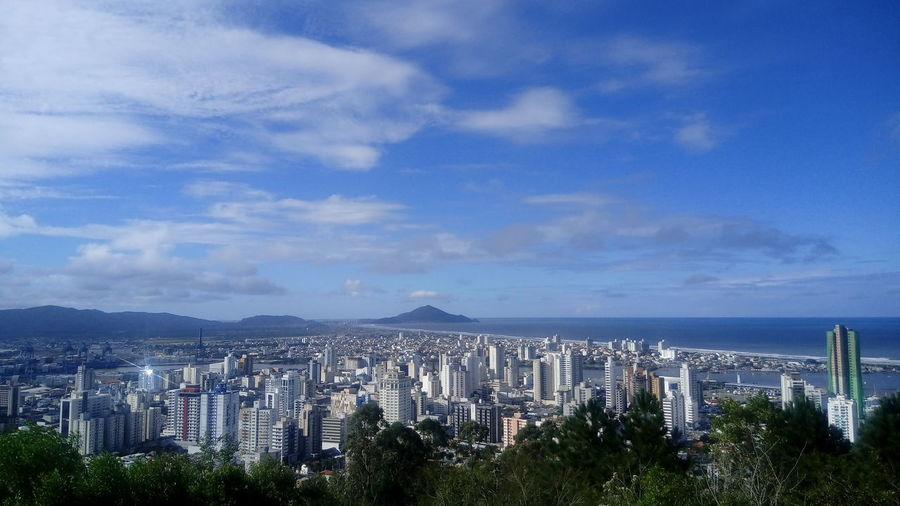 Aerial view of itajai up against cloudy sky