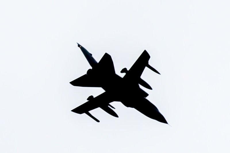 """Actually shot with """"typical"""" settings, through lightroom I transformed this picture into something more.. schematic I guess. It has something to it. Close-up Day Extreme Black And White Fighter Jet Fighter Plane Jet Low Angle View No People Outdoors Silhouette Sky Stylized Unreal White Background"""
