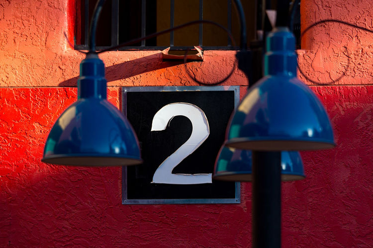 2 Blue Close-up La Placita Village Lighting Equipment Multi Colored No People Numbers Outdoors Pink Color Red Reflection Two