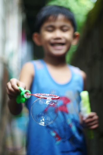 Bubbles Boy Playtime Human Hand Portrait Smiling Happiness Looking At Camera Water Holding