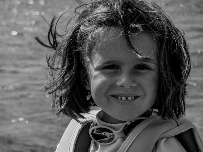 Black And White Childhood Close-up Day Elementary Age Girls Hair Happiness Headshot Looking At Camera Nature One Person Outdoors Portrait Portraits Real People Smiling The Portraitist - 2017 EyeEm Awards Water Wind