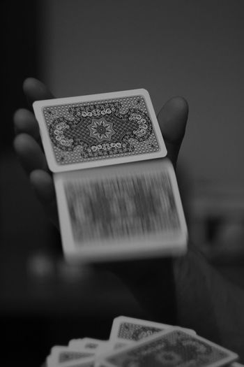 Blurred Motion Of Cards Falling From Hand At Home