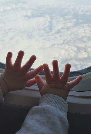 Flying high Cropped Babyhands Fingers Touching Window Glass Looking Out Flying High In A Plane On Holidays First Flight Clouds And Sky Exploring Curiosity Toddler Life Taking A Flight On My Way Two Is Better Than One Growing Up Babyfingers Showcase June White Background The OO Mission Blue And White Feel The Journey