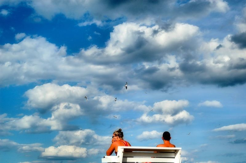 Watching over the swimmers at Lake Hopatcong, New Jersey. Bench Birds Blue Blue Sky Cloud Cloud - Sky Clouds Cloudy Day Flying Hopacong Lifeguards Low Angle View Outdoors People Sky Tranquility Watching Weather White