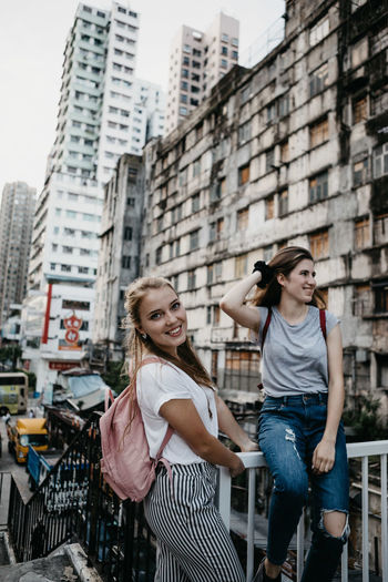 Smiling Friends Against Buildings In City