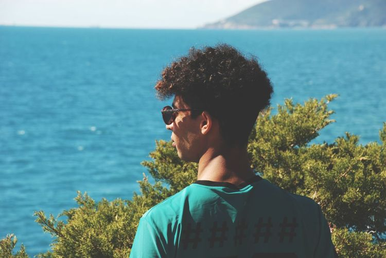 Sea view Blue Sky Colors Beautiful View Sun Sunlight Vegetation Green Blue Sky Light EyeEm Selects Only Men Sea One Man Only One Person Sunglasses Headshot Young Adult One Young Man Only Casual Clothing Day Water People Outdoors Nature
