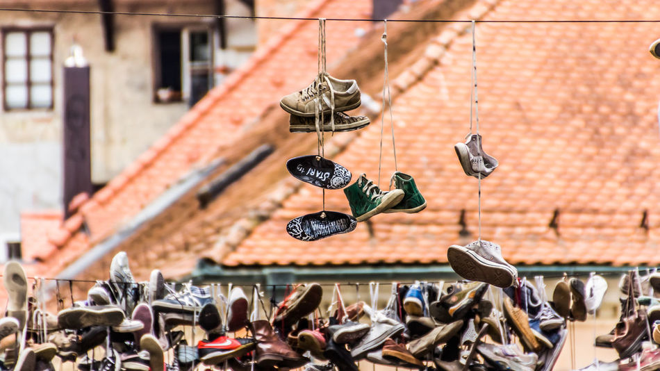 16:9 Day Focus On Foreground Hanging Hanging Large Group Of Objects No People Old Outdoors Roof Shoefiti Shoes Streetphotography
