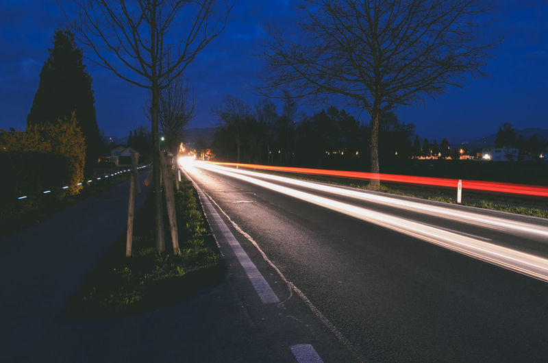 Bare Tree Blurred Motion Clear Sky High Street Illuminated Light Trail Long Exposure Motion Night No People Outdoors Road Sky Speed The Way Forward Transportation Tree HUAWEI Photo Award: After Dark