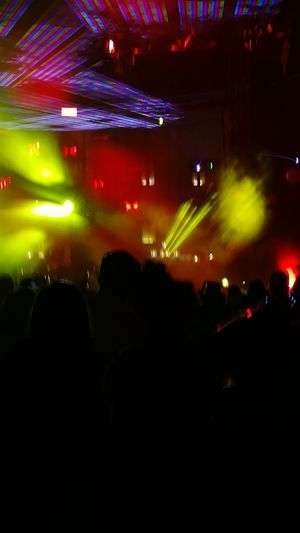 Audience Crowd Arts Culture And Entertainment Music Nightlife Large Group Of People Illuminated Silhouette Enjoyment Lighting Equipment Fun Excitement Night China Disney Rave Stage Light Performance People Indoors  Popular Music Concert New Year Stage - Performance Space Adult