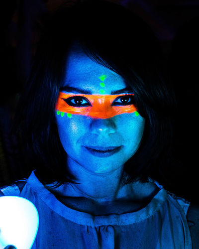 Glow Party. Adult Beautiful Woman Beauty Black Background Blue Close-up Face Paint Fluorescent Fluorescent Light Front View Headshot Human Face Illuminated Indoors  Lifestyles Looking At Camera Make-up One Person Paint Party Portrait Real People Women Young Adult Young Women