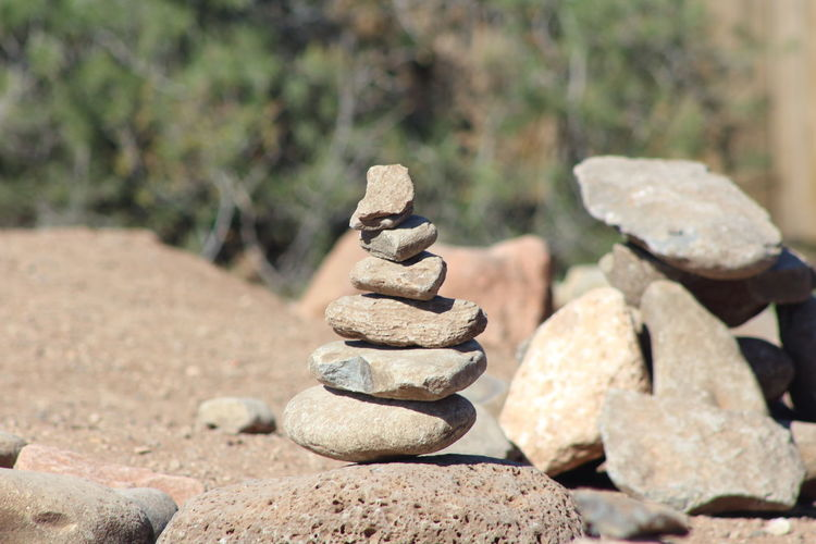 Solid Rock Balance Stone - Object Zen-like Stone Rock - Object Stack Focus On Foreground Pebble Nature No People Day Sunlight Land Tranquility Outdoors Close-up Stability Beach
