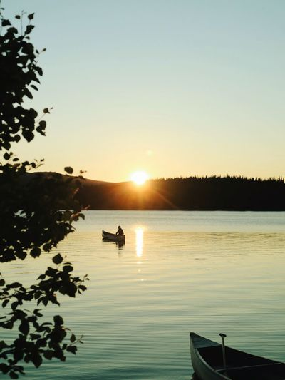 Canoeing Canoe Water Sky Sunset Beauty In Nature Scenics - Nature Silhouette Tranquility Nautical Vessel Clear Sky Tranquil Scene Tree Nature Mode Of Transportation Sunlight Lake Plant Reflection Outdoors Transportation Sun