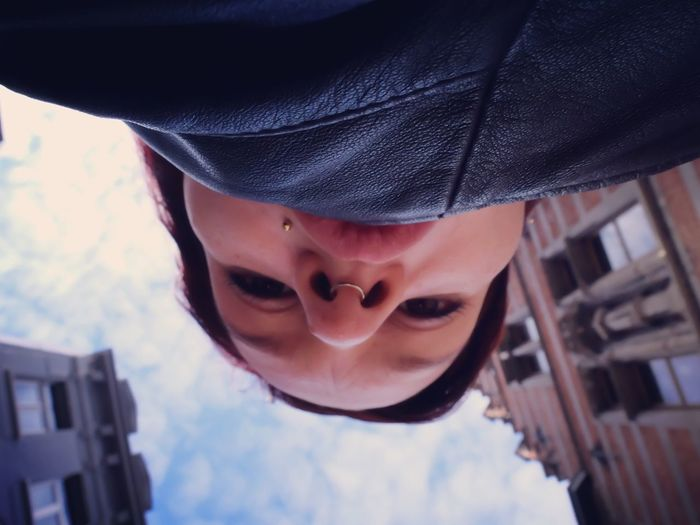 Directly below portrait of woman with nose ring against sky