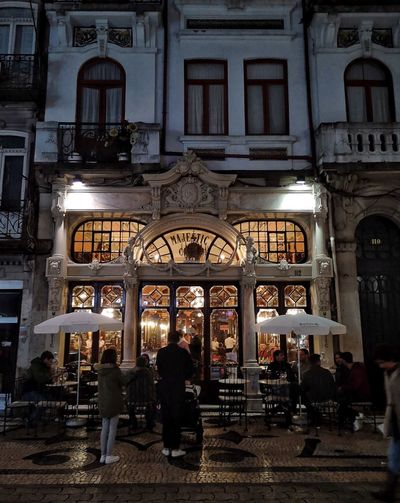 Cafe Architecture Built Structure Real People Group Of People Building Illuminated Building Exterior Arch Lifestyles People