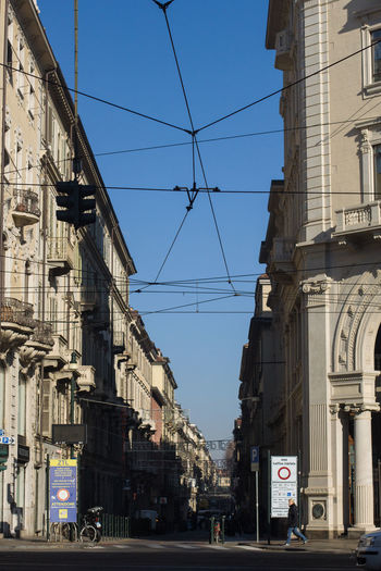 Architecture Built Structure City Building Day Cable Clear Sky Incidental People Residential District City Street City Life Blue Road Sunlight Outdoors