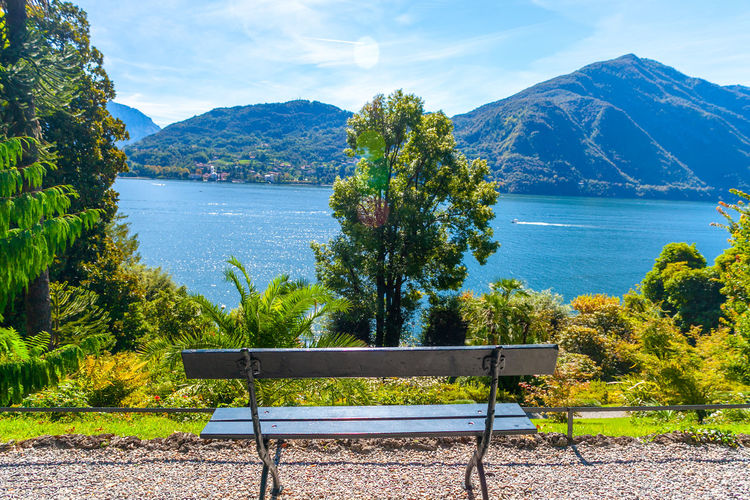 A bench to see the lansdscape of lake of como from garden of villa carlotta, lombardy, italy