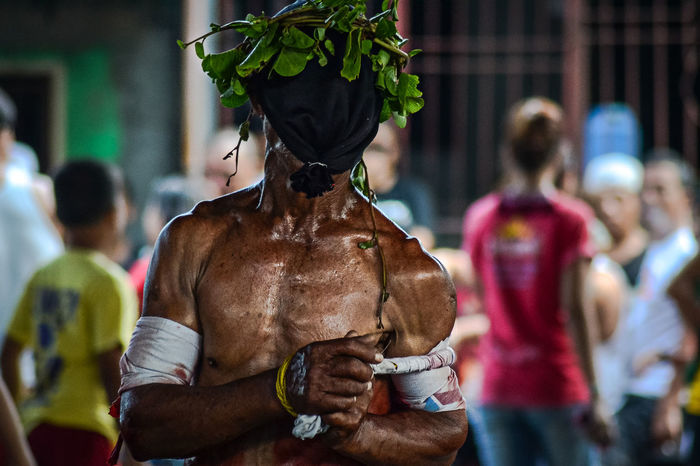 A penitent in Rosario, Cavite Philippines where self-flagellation during Good Friday has become a tradition. Arts Culture And Entertainment Good Morning Incidental People Lent Lenten Light And Shadow Masked Men Penitencia Penitensya Penitent Selective Focus Self-flagellation Street