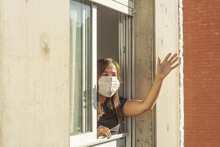 Woman drinking glass window