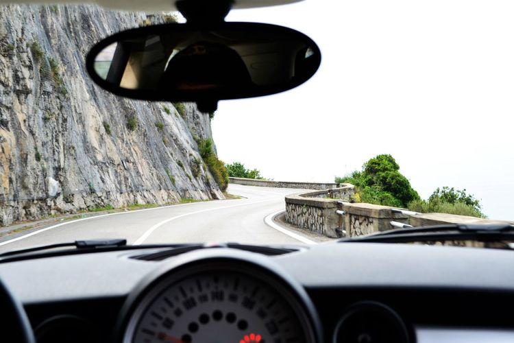 Street seen through windshield