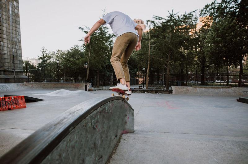 Full length of man skateboarding on skateboard park