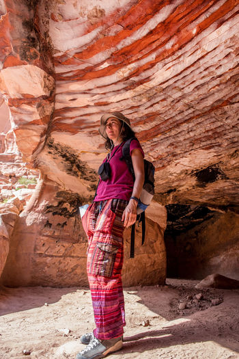 Woman standing in cave