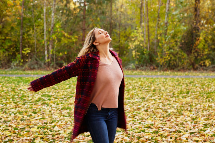 Adult Adults Only Autumn Beautiful Woman Beauty Carefree Casual Clothing Day Happiness Head Back Human Body Part Leaf Leisure Activity Long Hair Nature One Person One Woman Only One Young Woman Only Only Women Outdoors Smiling Standing Tree Young Adult Young Women
