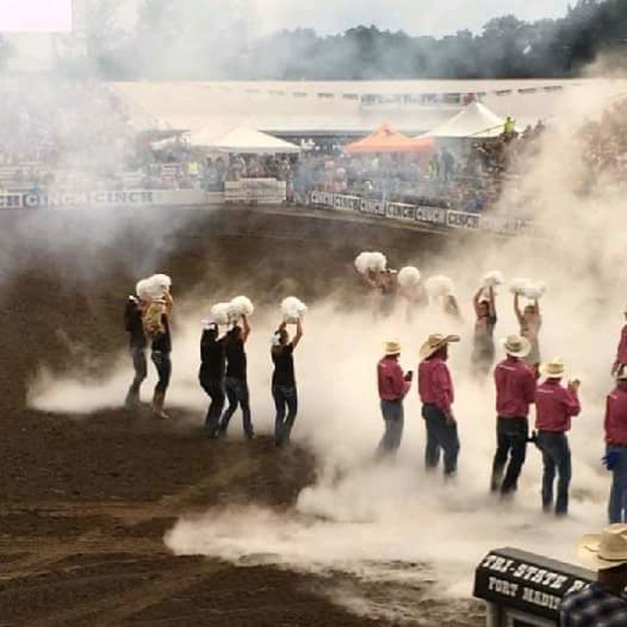 smoke - physical structure, large group of people, young men, men, young adult, adult, full length, day, running, adults only, standing, outdoors, togetherness, people, motion, young women, crowd, real people, only men, large group of animals, competition