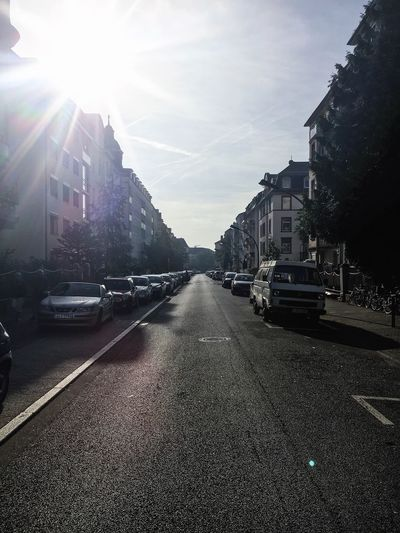 Architecture Building Exterior Sunbeam Car Transportation Built Structure Mode Of Transport Land Vehicle City Lens Flare Street Sun Sunlight Parking The Way Forward City Street Diminishing Perspective Sky Residential District City Life Frankfurt Am Main Ostend