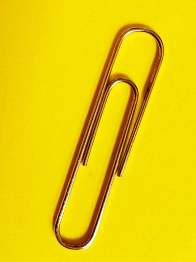 The Minimalist Paperclip Silver  Bright Yellow Office Supplies Macro