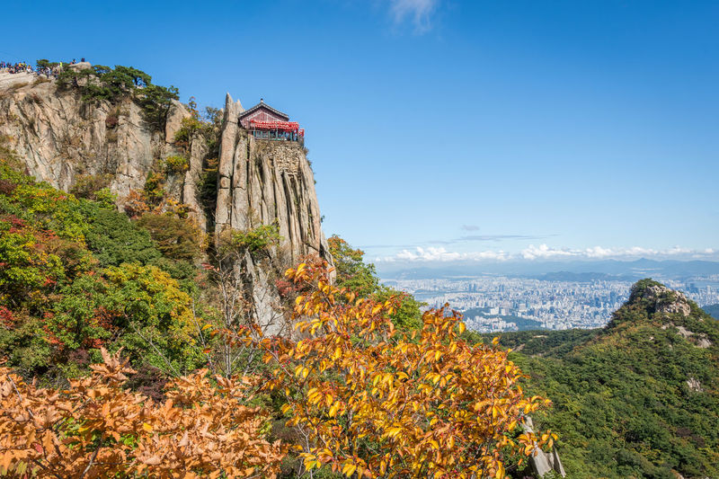 A view of Yeonjudae and Seoul from Gwanaksan in South Korea. Great hike up the mountain to this temple. ASIA Asian  Fall Beauty Fall Colors Hiking Mountain View Rock Rock Formation Seoul Seoul, Korea Sky And Clouds South Korea Temples Adventure Fall Gwanaksan Mountain Mountain Peak Mountains Mountains And Sky Outdoor Outdoor Photography Outdoors Sky Temple