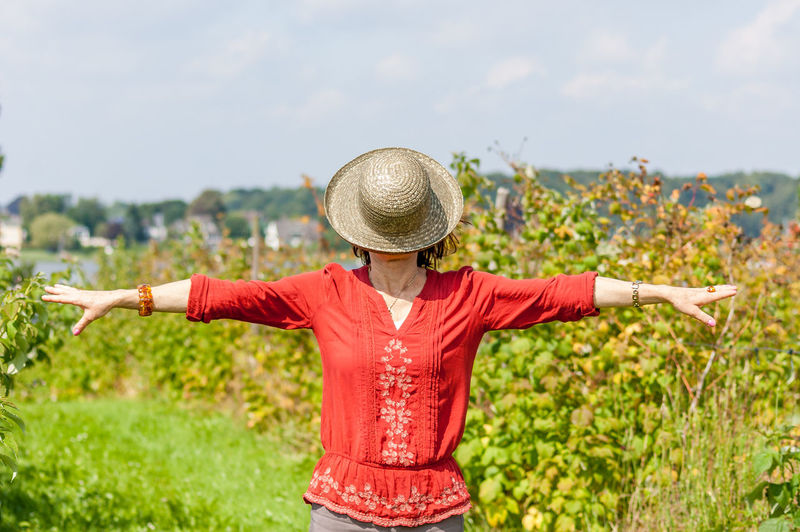 View of woman with hat standing against sky