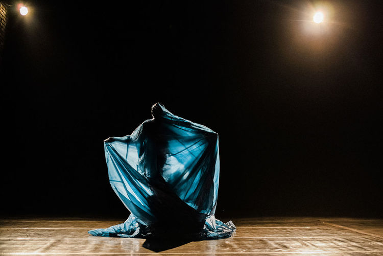 Blue Contemporary Art Illuminated Performance Theatre Woman Wrapped