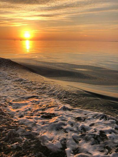 Sunset Sea Beach Beauty In Nature Water Sky Scenics - Nature Orange Color Land Sun Horizon Over Water Tranquility Idyllic Outdoors Horizon Tranquil Scene No People Cloud - Sky Sunlight Nature
