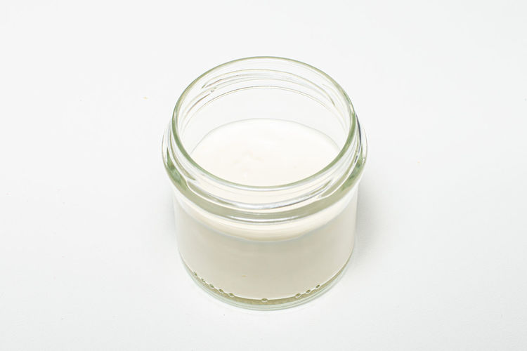 High angle view of glass jar on white background